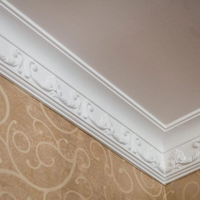 Luxury Home ceiling corner ornamental moulding detail.